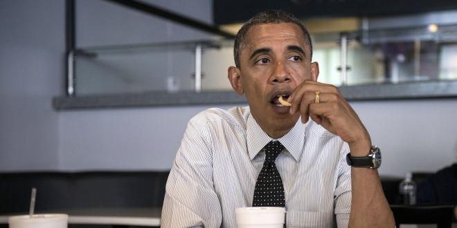 US President Barack Obama eats a french fry while meeting with supporters about voter registration at OMG Burgers on September 20, 2012 in Miami, Florida.  Obama is traveling to Florida for the day to participate in a taping for Univision in Miami before attending a campaign event in Tampa.  AFP PHOTO/Brendan SMIALOWSKI        (Photo credit should read BRENDAN SMIALOWSKI/AFP/GettyImages)
